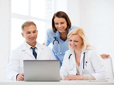 Doctors reviewing computer screen
